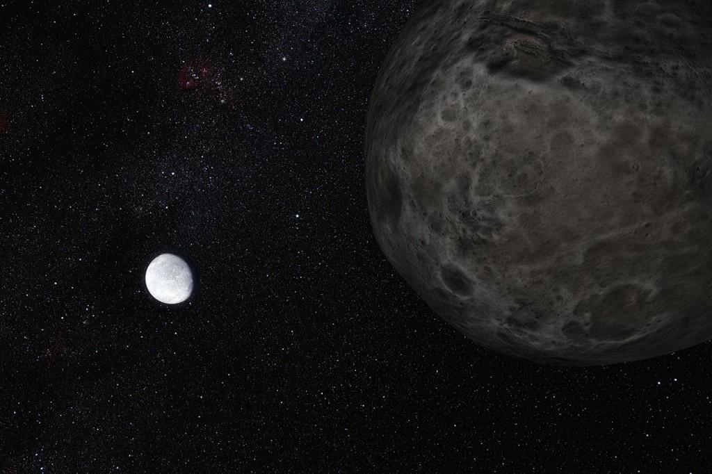 Eris und sein Mond Dysnomia befinden sich  im äußeren Sonnensystem - aber ist da noch mehr (Künstlerische Darstellung: ESO/L.Calcada)